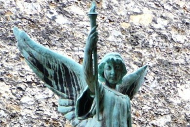Guardian Angel standing over the grave of Charles Pigeon (Montparnasse Cemetery, Paris)